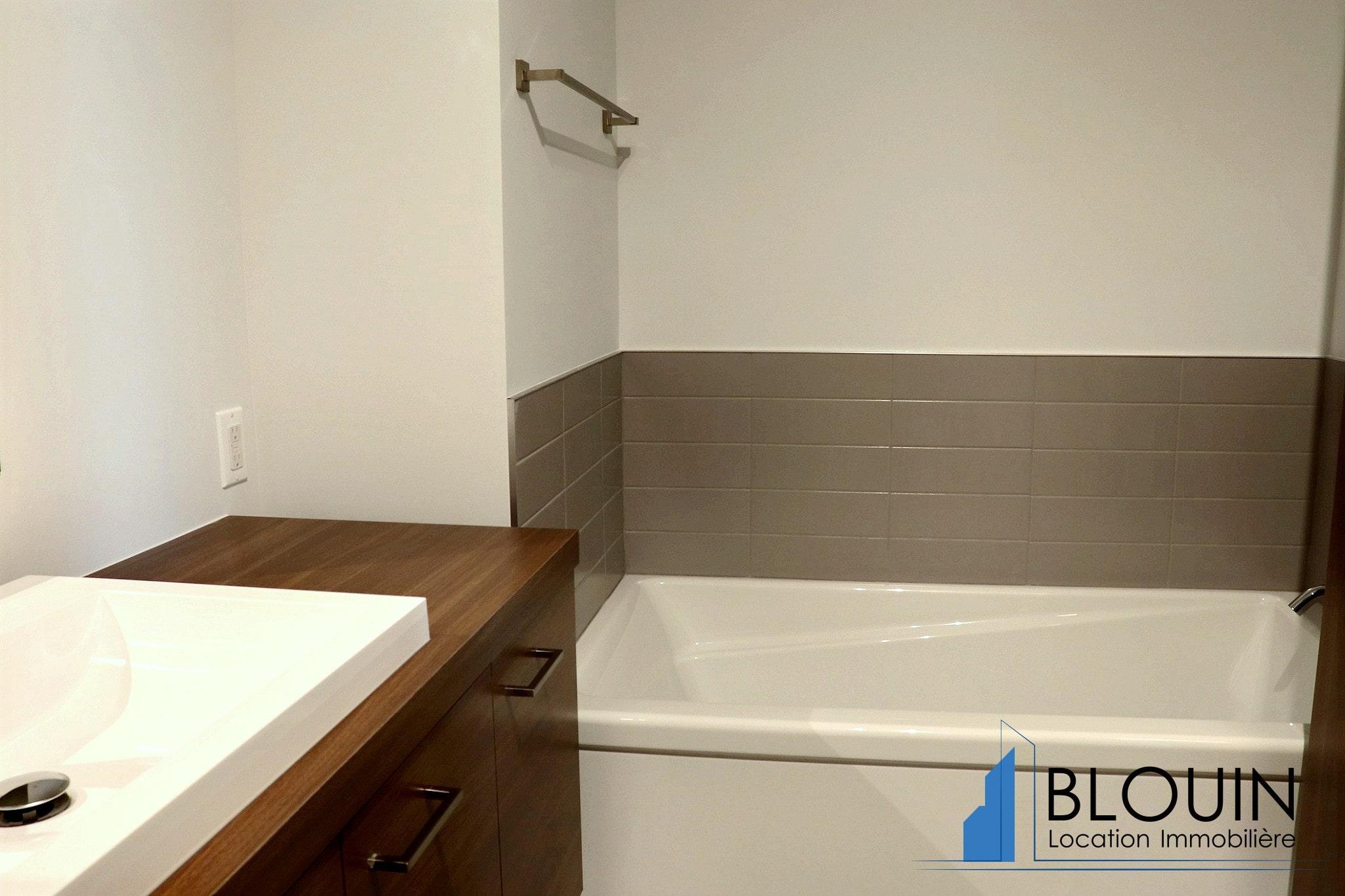 Photo 10 : 5 ½, Projet neuf Le Pivot, libre maintenant, eau chaude incluse & 2 stationnements