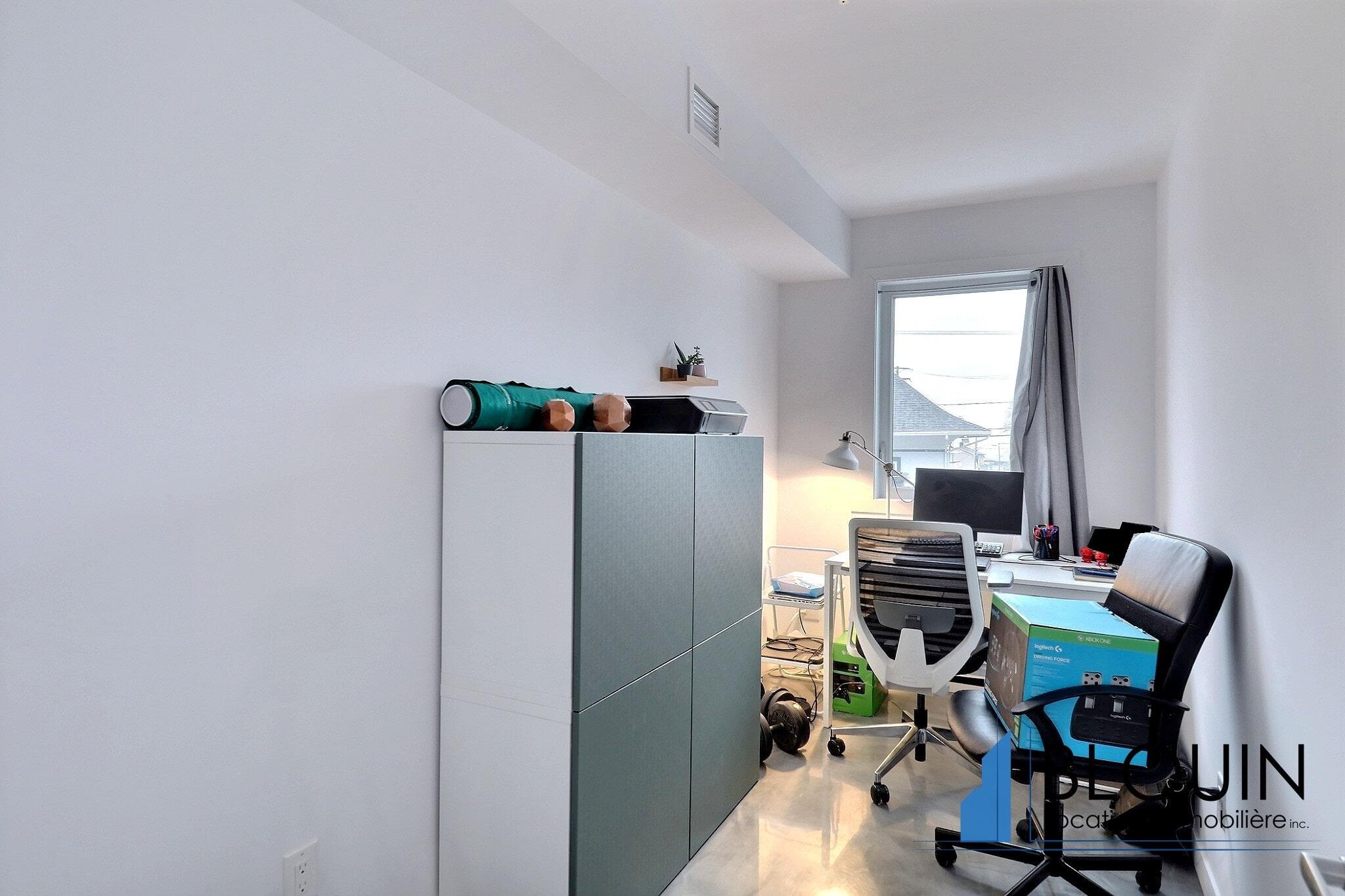 Photo 10 : Magnifique 3 ½ + Bureau, à Lévis, Moderne, Stationnement intérieur, Ascenseur, Belle vue
